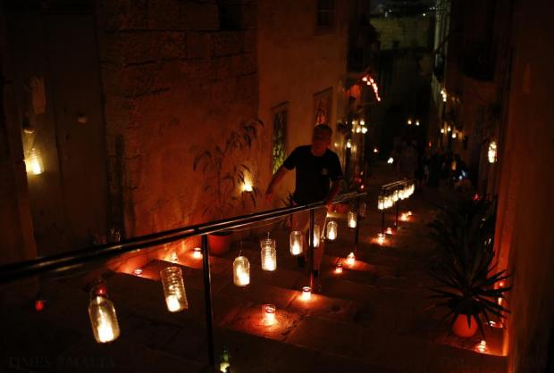 "A visitor attends the activity ""Birgu by Candlelight"" in Vittoriosa on October 10. During the annual event, most street lights are switched off and the fortified city is lit up by candlelight, creating a magical ambience. Photo: Darrin Zammit Lupi"