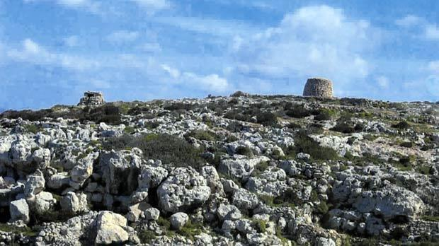 A humble girna (corbelled hut, right). These structures dot the northwest of the island, a precursor to the neolithic temples and magnificent church domes.