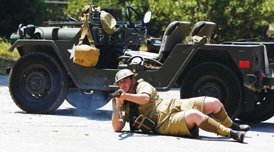 A British soldier fires his rifle in a re-enactment of what might have happened had the Germans landed on the island in World War II during yesterday's Military Mtarfa. Photo: Darrin Zammit Lupi