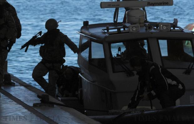 Members of the Armed Forces Special Ops team return ashore after a demonstration at the opening of the Maritime Squadron's new Base in Haywharf on January 11. Photo: Matthew Mirabelli