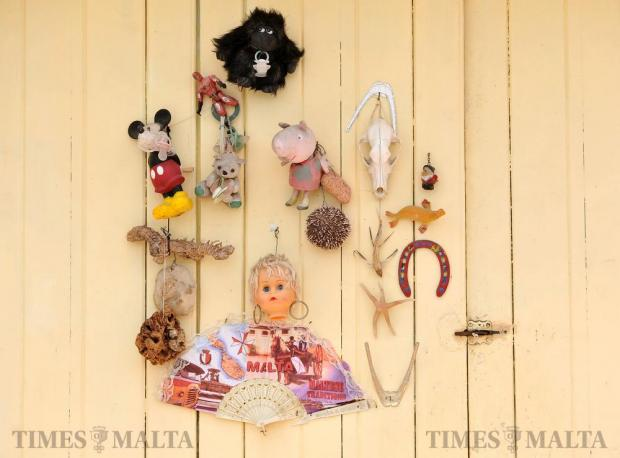 A collection of items hangs from a garage door in Marsaxlokk on May 25. Photo: Chris Sant Fournier