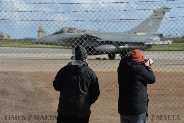 Plane spotters make the most of the opportunity to take photos of two French Rafale fighters after they were diverted to Malta on January 16. Photo: Matthew Mirabelli