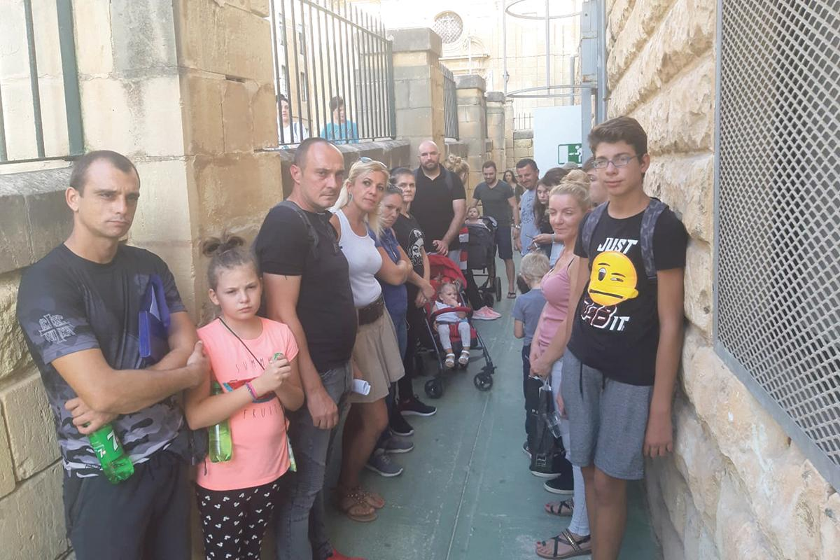 Families gathered at Identity Malta in September to demand the agency accept the residence permit applications for their children.