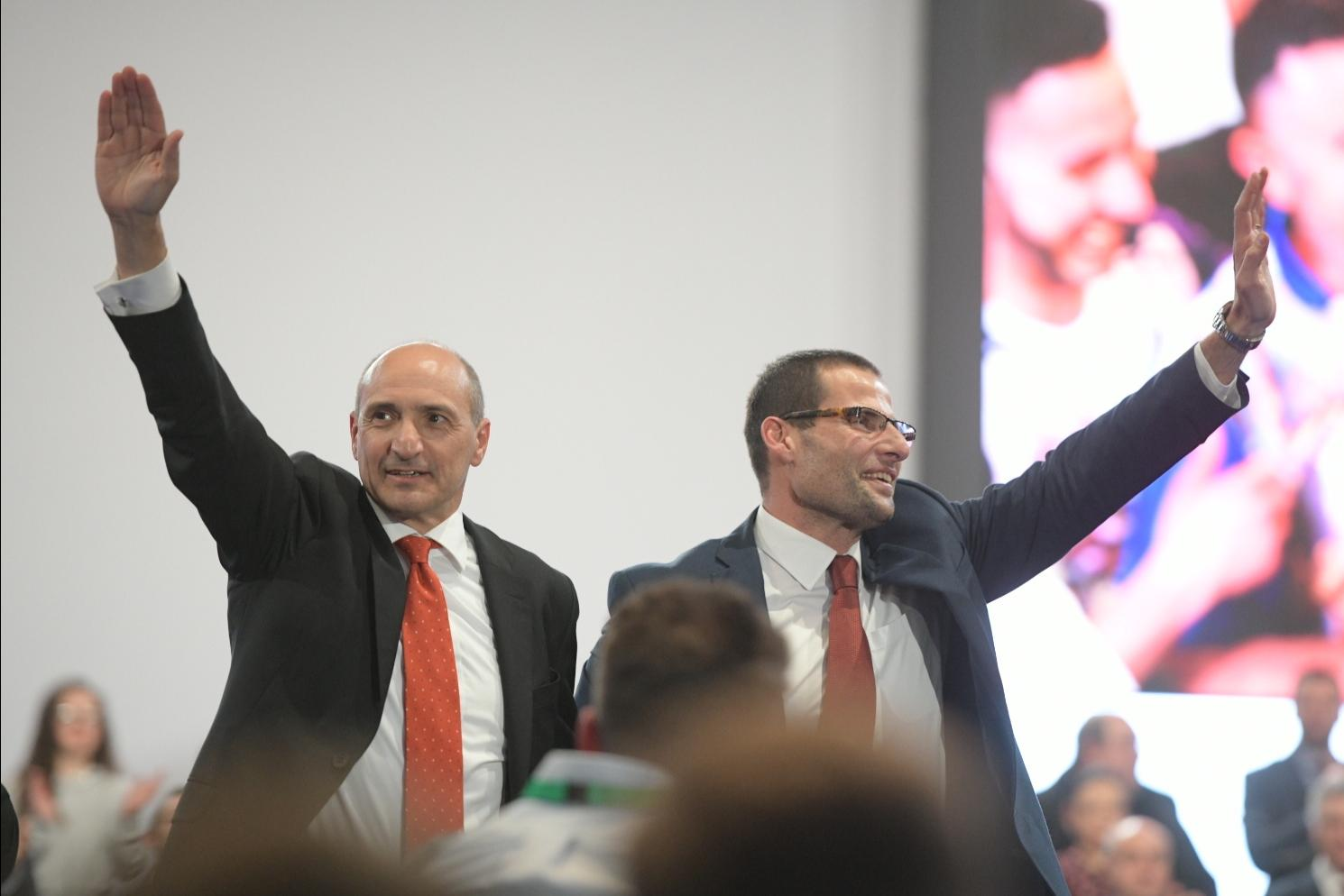 Chris Fearne (left) and Robert Abela (right) wave to a crowd gathered in Corradino to listen to outgoing PL leader Joseph Muscat's last speech. Photo: Matthew Mirabelli