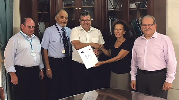C&C Express managing director Diana Cassar receiving the AEOF certification from Customs director general Joseph Chetcuti in the presence of Customs inspector and AEO contact point Francis Callus, C&C Express QA manager John Azzopardi and Customs procedures and AEO programme advisor Paul Bonello.