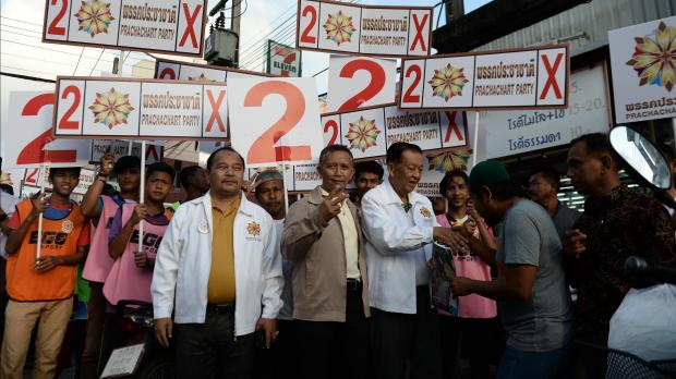 Prachachat Party leader Wan Muhamad Noor Matha campaigns with party candidates during a rally in a market in Narathiwat.