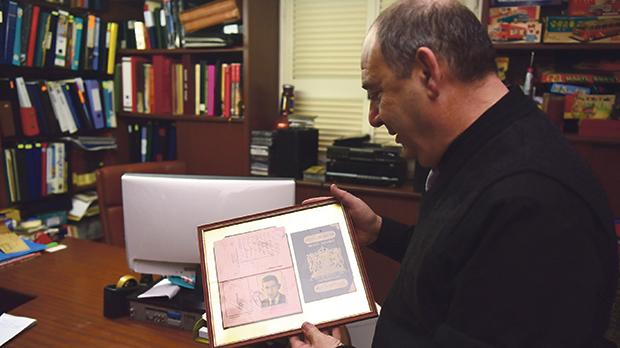 Mr Stivala is an avid collector of Maltese memorabilia. He is seen here holding the first passport of former Maltese prime minister George Borg Olivier.