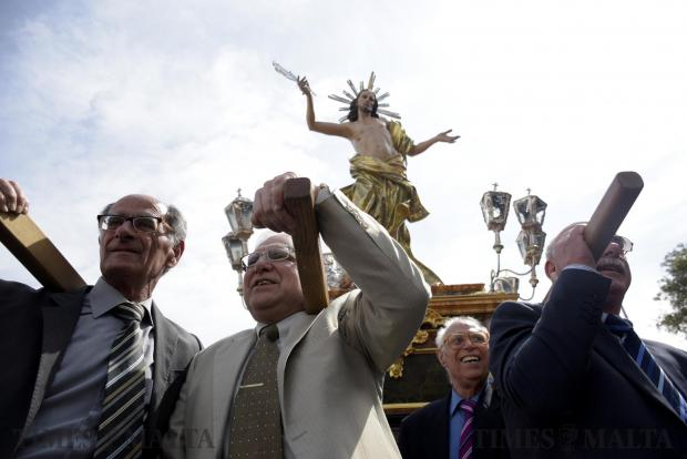 Procession goers lift the statue of the risen Christ during a procession in Cospicua on April 16. Photo: Mark Zammit Cordina