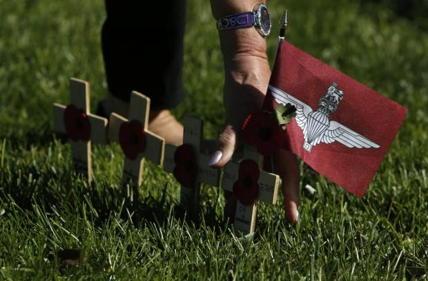 Remembrance crosses and a British Parachute Regiment flag are placed in the ground near the war memorial cenotaph after the Remembrance Sunday ceremony in Floriana on November 13. Photo: Darrin Zammit Lupi