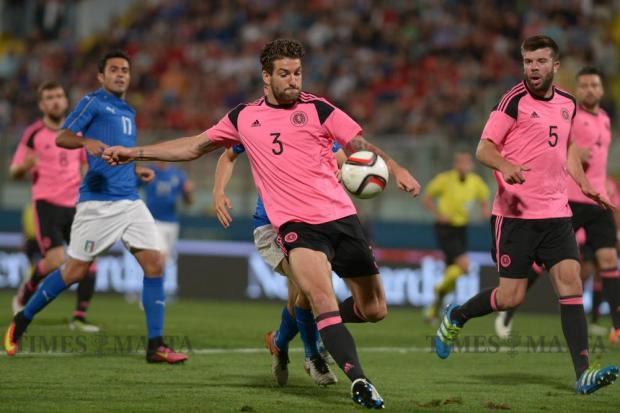 Scotland's Charlie Mulgrew kicks the ball during the International friendly football match against Italy at the National Stadium in Ta' Qali on May 29. Photo: Matthew Mirabelli