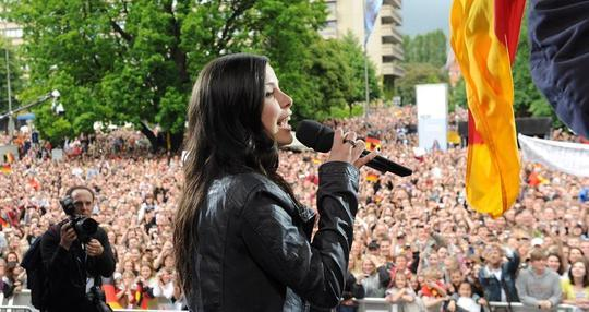 "Lena Meyer-Landrut, winner of the Eurovision Song Contest 2010, sings during a reception in her home town of Hanover, central Germany, on May 30, 2010, one day after competing in the contest. Lena Meyer-Landrut (19), who just finished her final school exams, stunned the country by besting artists from 24 other countries in Oslo with her catchy pop number ""Satellite""."