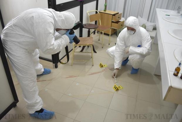 Forensic police examine evidence as part of a five-week training course given by the Netherlands Forensic Unit at the police academy in Mqabba on July 5. Photo: Mark Zammit Cordina
