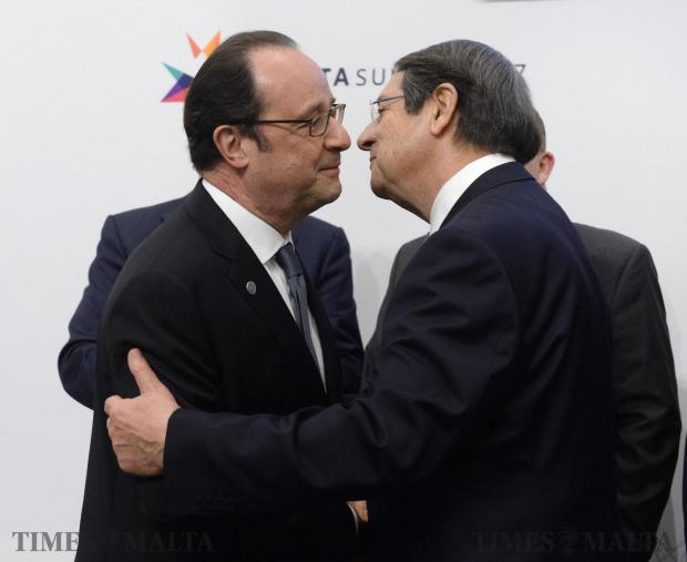 France's President Francois Hollande (L) greets President of Cyprus Nicos Anastasiades during a European Union summit on February 3, 2017 in Valletta. Photo: Matthew Mirabelli