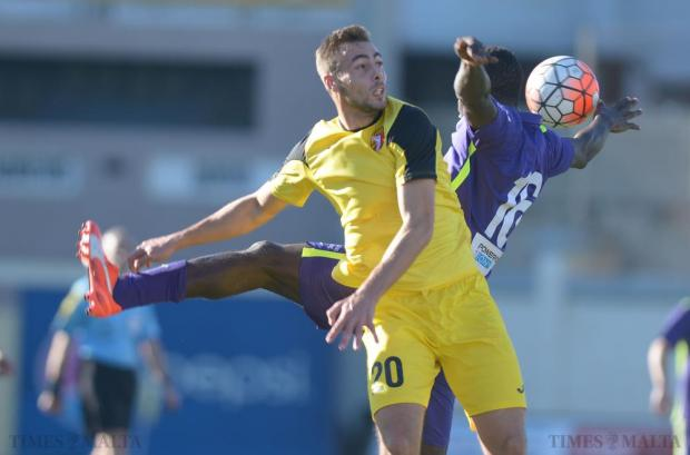 Qormi's Djamel Leeflang (right) and St Andrew's Edafe Uzeh fight for the ball during their Premier League match at Tedesco Stadium in Hamrun on December 12. Photo: Matthew Mirabelli