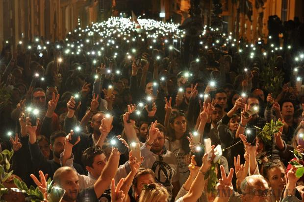 Demonstrators hold up mobile phones at the demonstration organised by the Civil Society Network in Sliema on October 29. The demonstration was organised in the wake of the assassination of journalist Daphne Caruana Galizia 3 weeks ago. Photo: Chris Sant Fournier