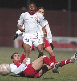 Njongo Priso in action for Msida in a league match against Valletta.