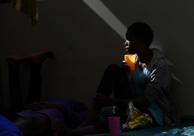 A migrant drinks water on the deck of the Medecins san Frontiere (MSF) rescue ship Bourbon Argos somewhere between Libya and Sicily on August 8. The 241 mostly West African migrants on the ship were taken to Trapani in Sicily. Photo: Darrin Zammit Lupi