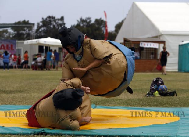 Children in sumo suits play at the fun park set up at the Marsa sports grounds as part of the Puttinu Cares annual fund raising sports marathon on May 29. Photo: Darrin Zammit Lupi