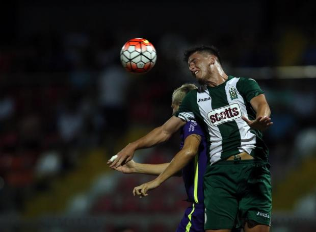 Floriana's Enzo Ruiz(front) beats St Andrew's Ryan Darmanin in an aerial challenge during their Premier League football match at the Hibernians Stadium in Corradino on August 27. Photo: Darrin Zammit Lupi