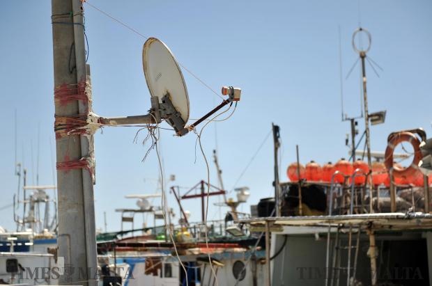 A satellite TV dish provides a signal to a fishing boat at Marsaxlokk on April 18. Photo: Chris Sant Fournier