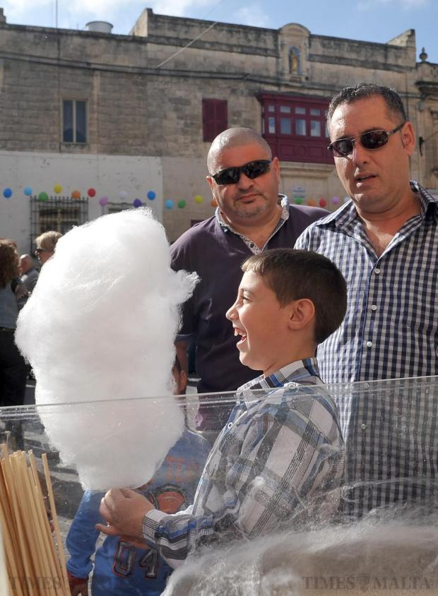 A boy is pleased with his candy floss at the Banana Festival in Qormi on November 16. Photo: Chris Sant Fournier