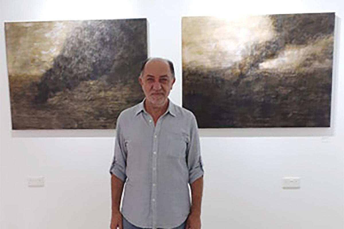 Vince Briffa with two works from the Between Ash and Dust Series.