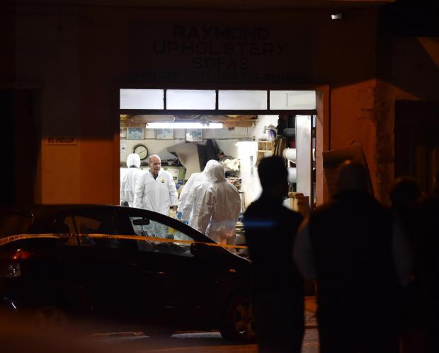 Members from Forensic unit inspect a garage where a man was brutally murdered and another severely wounded in Attard on November 17. Photo: Mark Zammit Cordina