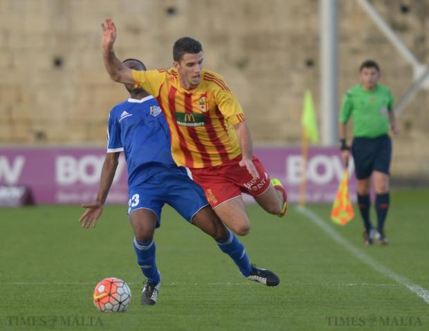 Birkirkara's Vito Plut (right) is brought down by Mosta's Ekani Rodriguez during their Premiership league match at the Hibernians stadium in Paola on December 19. Photo: Matthew Mirabelli