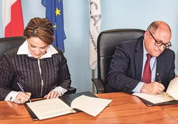 Mrs Muscat and Prof. James Calleja during the signing ceremony.