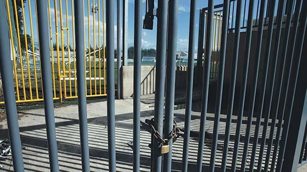 The locked gate at Mosta's Charles Abela Stadium. Photo:Darrin Zammit Lupi