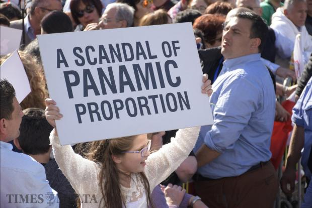 A girls holds up a placard referring to the Panama Papers scandal during an anti-corruption protest in Valletta on April 23. Photo: Mark Zammit Cordina
