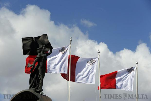 Maltese flags fly behind Malta's Independence Monument during a ceremony marking the 52nd anniversary of Malta's independence in Floriana, on September 21. Photo: Darrin Zammit Lupi