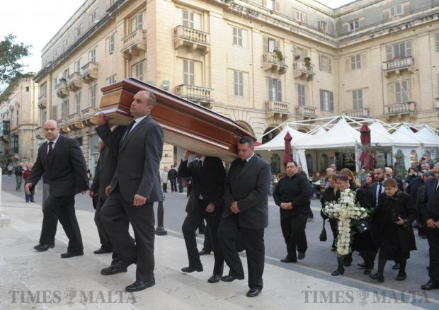 The body of Archbishop Emeritus Joseph Mercieca is carried into St John's Co-Cathedral in Valletta on March 21. Photo: Matthew Mirabelli
