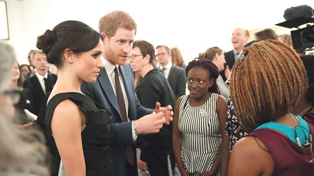Meghan Markle and Prince Harry with guests at the Women's Empowerment reception. Photo: Reuters