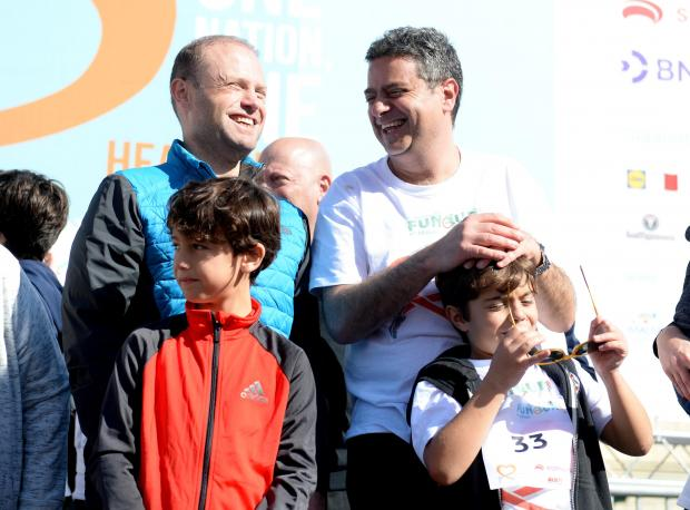 Joseph Muscat and Opposition leader Adrian Delia share a light moment in St George's Square after completing the President's Fun Run on November 19. Photo: Matthew Mirabelli