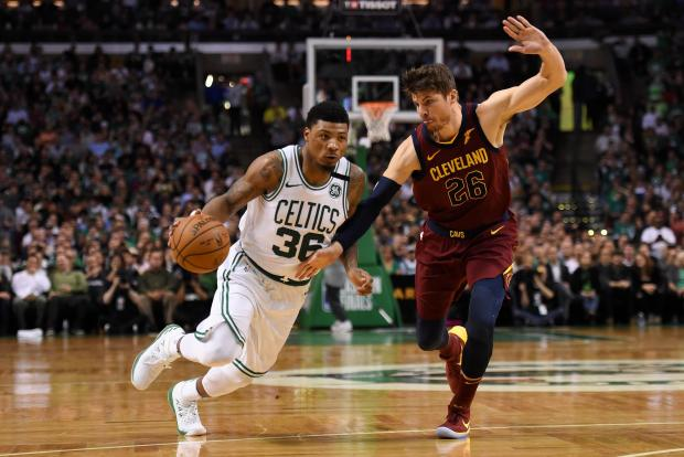 Boston Celtics guard Marcus Smart (36) drives against Cleveland Cavaliers guard Kyle Korver (26) during the third quarter in game two of the Eastern conference finals of the 2018 NBA Playoffs at TD Garden. Photo Credit: Bob DeChiara-USA TODAY Sports