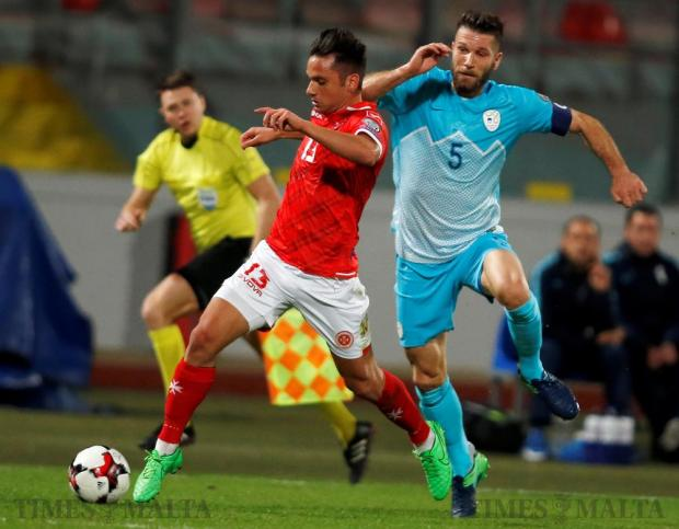 Malta's Andre Schembri fights for the ball with Slovenia's Bostjan Cesar during their 2018 World Cup qualifying match at the National Stadium in Ta'Qali on November 11. Photo: Darrin Zammit Lupi