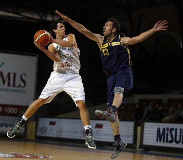 Depiro's Vangelis Vlachos (right) tries to block Floriana's Chad Patus during their National League basketball match at the Ta'Qali Pavilion on December 20. Photo: Darrin Zammit Lupi