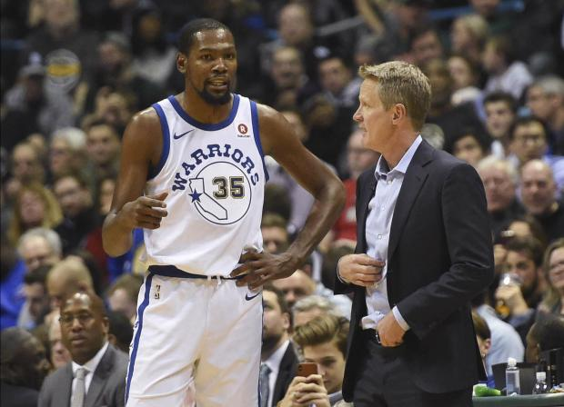 Golden State Warriors head coach Steve Kerr talks to forward Kevin Durant (35).