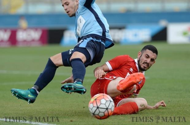 Tarxien Rainbow's Sacha Borg (right), slides in for a tackle during their FA trophy match at the National Stadium in Ta'Qali on May 13. Photo: Matthew Mirabelli