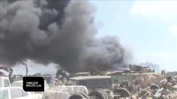 Scrapyard catches fire, cameramen attacked