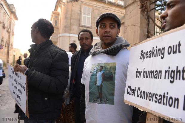 Eritreans and Ethiopians gather after mass in Balzan on January 17 to mourn the death of fellow migrants who committed suicide. During the gathering they appealed to the authorites to hear their desperate plea for better living conditions. Photo: Matthew Mirabelli