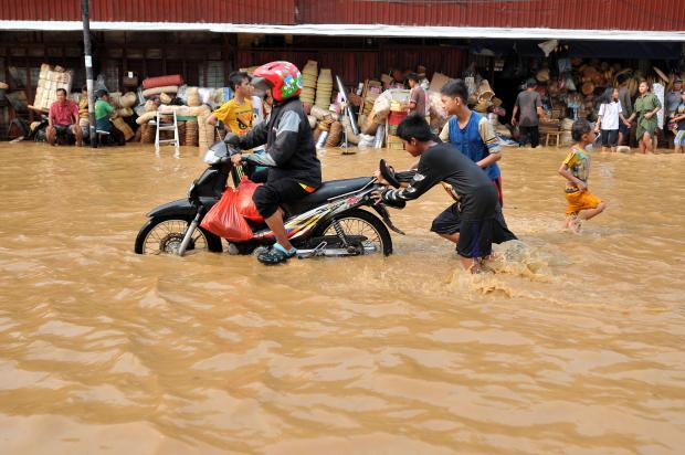 Yearly floods cause massive headaches in the Indonesian capital. Photo: AFP