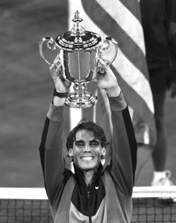 Rafael Nadal lifts the US Open trophy.
