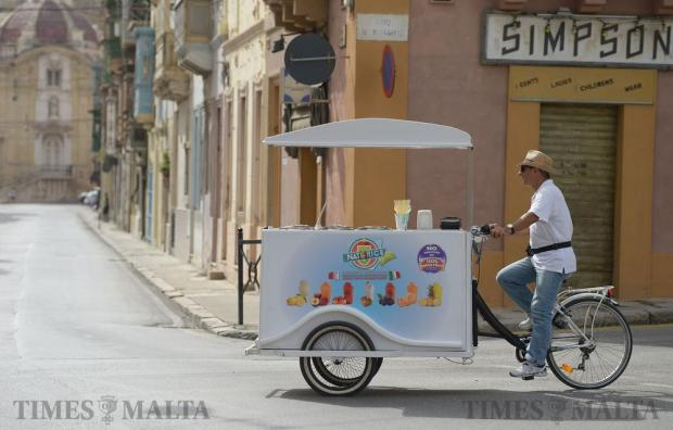 An ice cream vendor rides his tricycle just outside Senglea on October 14. Photo: Matthew Mirabelli