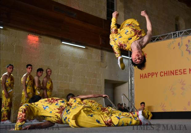 A performer from China's Zhejiang Wu Opera Troupe does a backflip on stage during the Chinese new year celebrations held in Valletta on February 14. Photo: Mark Zammit Cordina