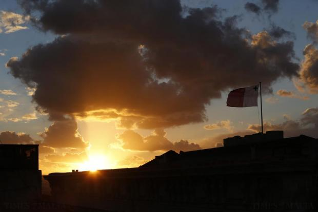 A Maltese flag flies over Auberge de Castille in Valletta at sunset on January 28. Photo: Darrin Zammit Lupi