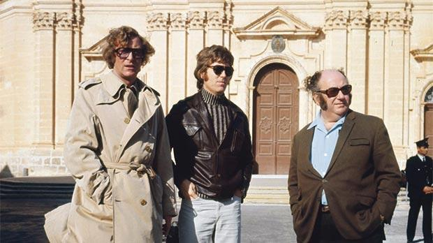 Michael Caine (left) with the crew of Pulp in front of Mdina Cathedral.