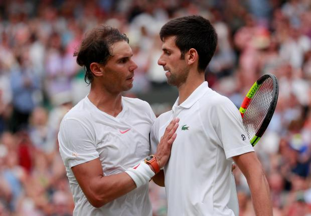 Rafa Nadal (right) congratulates Novak Djokovic after the Wimbledon semi-final.