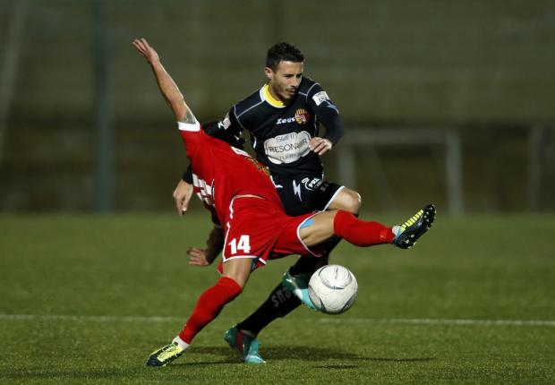 Qormi's Duncan Pisani (right) and Tarxien Rainbows' Carlos Hevia (left) fight for the ball during their Premier League football match at the Tedesco Stadium in Hamrun on January 27. Photo: Darrin Zammit Lupi